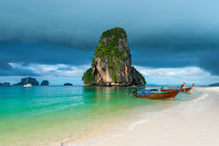 Wooden boats and a high cliff in the sea, Thailand Royalty Free Stock Image