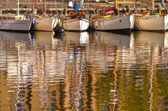 Wooden boats in Hobart. Wooden boats assembled for a Wooden Boat Festival at Constitution Dock in Hobart, with reflections Stock Photo