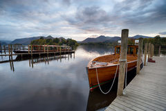 Wooden Boats at Keswick. Wooden boats moored at piers on Derwent Water at Keswick in the Lake District in Cumbria Royalty Free Stock Photos