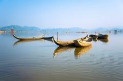 The wooden boats on lake. DAK LAK- VIETNAM: the fishing wooden boats anchoring on the lake in Lak, Dak Lak province, Vietnam stock photos