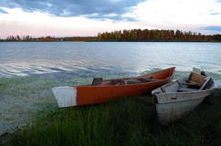 Wooden boats on the lake. Old wooden boats (kayaks) on the lake in Eastern Siberia, Yakutia, Russia Stock Image
