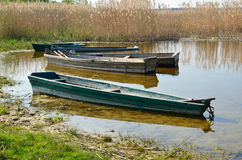 Wooden boats on the lake shore Royalty Free Stock Image