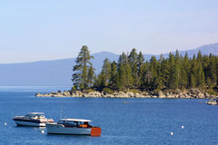 Wooden boats on Lake Tahoe. Tranquillity of the boats moored in the cove on Lake Tahoe Royalty Free Stock Image