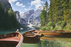 Wooden boats on lake. Beautiful sunny morning at Lago di Braies in Dolomite Alps - South Tyrol, Italy stock photo