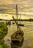 Wooden Boats on Loire Valley. Wooden boats on the Loire Valley in France during an autumn evening day Royalty Free Stock Photo