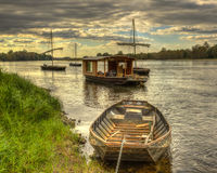 Wooden Boats on Loire Valley. Wooden boats on the Loire Valley in France during an autumn evening day Stock Photos