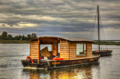 Wooden Boats on Loire Valley. Wooden boats on the Loire Valley in France during an autumn evening day Stock Photo