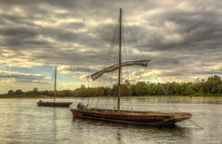 Wooden Boats on Loire Valley. Wooden boats on the Loire Valley in France during an autumn evening day Royalty Free Stock Image
