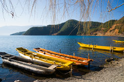 Wooden boats in the Lugu lake Stock Photography