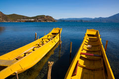 Wooden boats in the Lugu lake Royalty Free Stock Photos