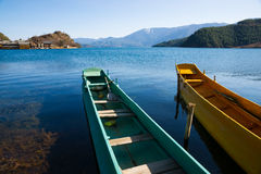 Wooden boats in the Lugu lake Royalty Free Stock Images