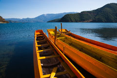 Wooden boats in the Lugu lake Stock Photos