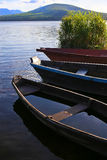 Wooden boats on mountain lake Stock Photography