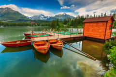 Wooden boats on the mountain lake,Strbske Pleso,Slovakia,Europe. Stunning mountain lake with colorful wooden boats in the National Park High Tatras,Strbske Pleso Royalty Free Stock Photography