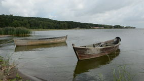 Wooden boats near sea coast. Two wooden boats near sea coast stock footage