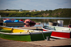 Wooden Boats with Paddles in a Lake Royalty Free Stock Photography