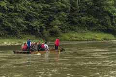 Wooden boats with passengers on Dunajec river royalty free stock photography
