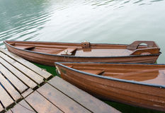 Wooden boats at pier Stock Images