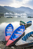 Wooden boats on Pokhara Lake in Nepal Stock Photo