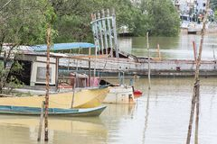 Wooden boats on the River. Old boats on waterfront reflected in river Royalty Free Stock Images