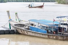 Wooden boats on the River. Old boats on waterfront reflected in river Royalty Free Stock Photography
