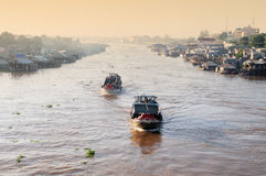 Wooden boats running on Mekong river in Mekong Delta, Vietnam Stock Images