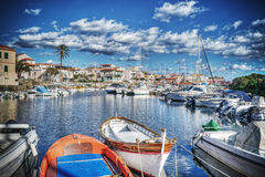 Wooden boats in Stintino harbor in hdr Stock Photography