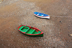 Wooden boats stranded due low tide Stock Images