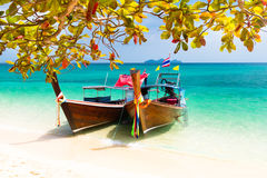 Wooden boats on a tropical beach. Stock Photo