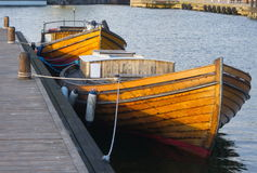 Wooden boats. Two old fishing boats at the quay Stock Photography