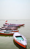 Wooden boats, Varanasi, Rajasthan, India. Colourful old wooden boats aligned for cruises on the Ganges River Stock Photos