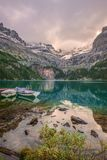 Wooden boats waiting for tourists at Lake O`Hara.Yoho National Park.British Columbia.Canada royalty free stock photo