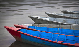 Wooden boats on the water Stock Photos