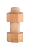Wooden bolt with screw nut. Royalty Free Stock Image