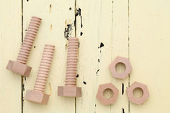 Wooden bolts and nuts Royalty Free Stock Image