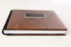 Wooden book with metal shild Stock Photo