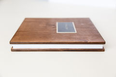 Wooden book with metal shild Stock Images