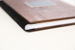 Wooden book with metal shild Royalty Free Stock Image