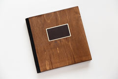 Wooden book with metal shild Stock Photos