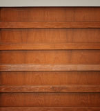 Wooden book shelf. Brown wooden book shelf background Royalty Free Stock Photos