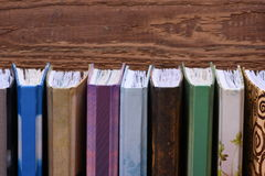 Wooden book shelf with notebooks. Closeup Stock Image