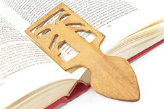 Wooden bookmark. In a book Royalty Free Stock Photo