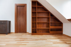 Wooden bookshelf in the attic. View of wooden bookshelf in the attic stock images