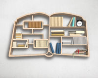 Wooden bookshelf in book shape on wall Royalty Free Stock Photo