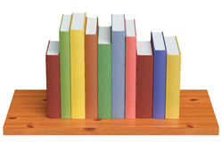 Wooden bookshelf with colored books Royalty Free Stock Photo