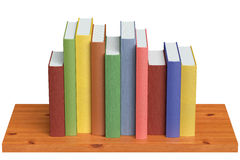 Wooden bookshelf with colored books Stock Photo