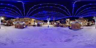 Wooden booths at night in Roses` Square Piața Trandafirilor, Târgu Mureș. 360 panorama of decorated wooden booths in winter nighttime in a snow-covered Piața Stock Photography