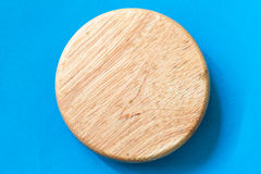 Wooden bord on blue paper Royalty Free Stock Photography