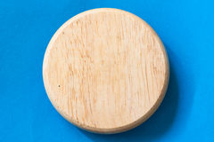 Wooden bord on blue paper Stock Image