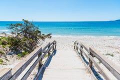 Wooden bordwalk in Maria Pia beach Royalty Free Stock Photo